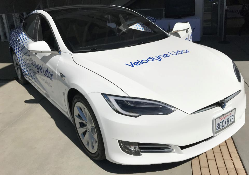 Photo of A Tesla with a Velodyne Lidar